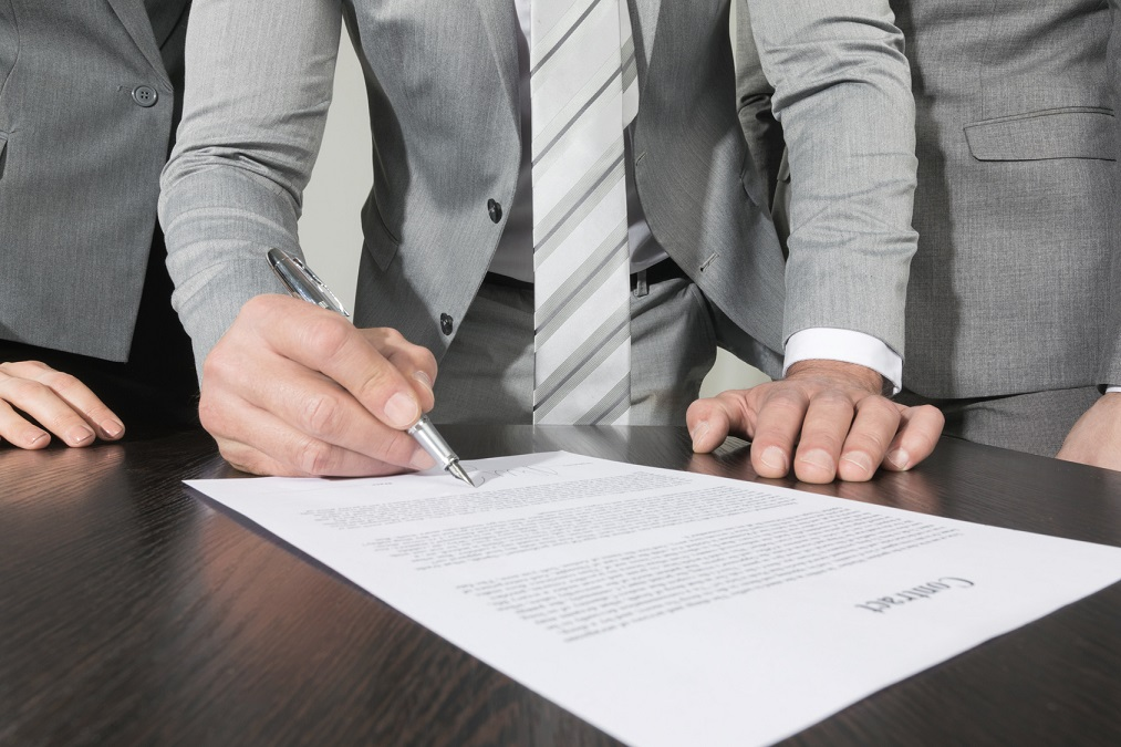 Group of business people sign a contract finishing deal